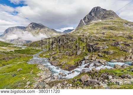 Norwegian Mountain Landscape With Trollstigen Center In The Background, National Scenic Route Geiran