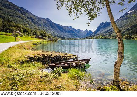 Panoramic View With Rowing Boat And White Berk Tree Alonglake Oldevatnet In Valley Oldedalen In Norw
