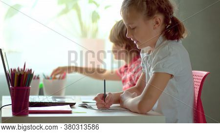 Cute Children Use Laptop For Education, Online Study, Home Studying, Boy And Girl Have Homework At D