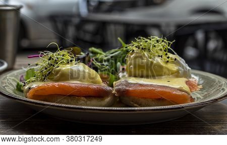 Selective Focus. Delicious Breakfast Or Brunch, Egg Benedict With Smoked Salmon, And Green Lettuce
