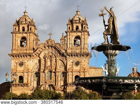 Statue Of Inca Pachacutec On Fountain And Catholic Church On Plaza De Armas, Cusco Or Cuzco Town, Pe