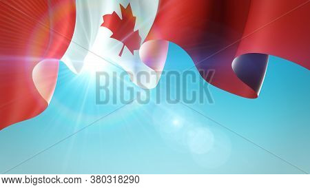 The Sun Shines With Golden Rays Through The Waving Flag Of Canada. Canada Waving Flag On Blue Sky Fo
