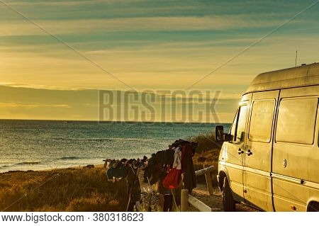 Camping On Beach, Adventure Concept. Clothes Hanging To Dry On Laundry Line Outdoor By Camper Car