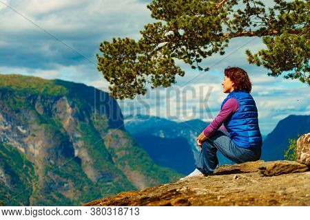 Tourist Woman On The Mountain Top Looking At View Of Mountains, Norway. National Tourist Scenic Rout
