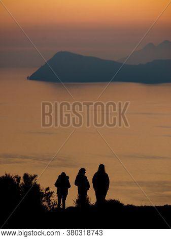 Rear View People Family Silhouette Looking At Horizon Enjoying Coastal Landscape At Sunset. Mesa Rol