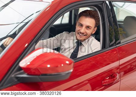 Happy Bearded Man In Shirt And Tie Smiling And Looking At Camera While Checking New Vehicle During W