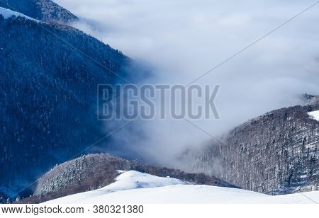 Winter View Of Foggy Mountain Valley And A Mountain Hut In The Foreground