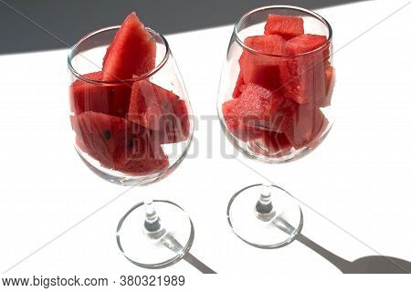 Close Up Diced Red Watermelon In Wineglass, Isolated On White.
