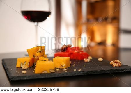 Delicious Gouda Cheese And Walnuts On Table, Closeup