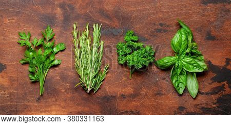 Various garden herbs on wooden table. Top view flat lay