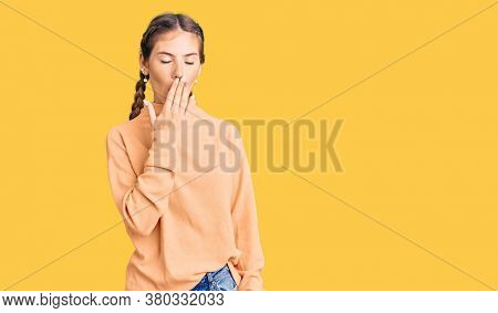 Beautiful caucasian woman with blonde hair wearing casual winter sweater bored yawning tired covering mouth with hand. restless and sleepiness.
