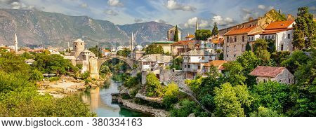 Panorama Mostar Bridge In Bosnia And Herzegovina. Colorful Landscape In The City Of Mostar With A Br