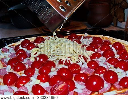 Homemade Pizza. Preparation. Pizza With Sausage, Fresh Tomatoes (cherry) And Sweet Pepper, Onion, Ch