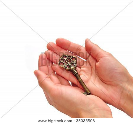 Beautiful Bronze Key In Hands Isolated On White Background
