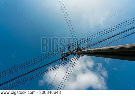 Looking Up View Of Three-phase Electric Power For Transfer Power By Electrical Grids. High Voltage E
