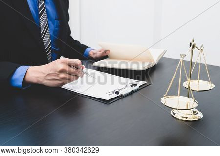 A Professional Male Lawyer Who Works At A Law Firm Has Scales, Scales Of Justice, Documents About Ju