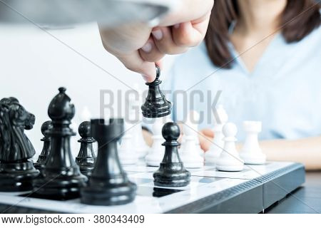 The Hands Of Businessmen Moving Chess In Chess Competitions Demonstrate Leadership, Followers, And S