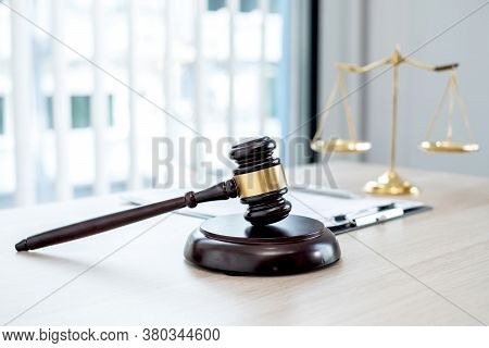 The Judge's Gavel At The Law Firm Has Scales, Scales Of Justice, And Litigation Documents. Concepts