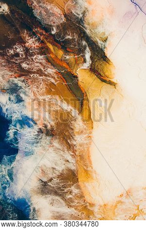 Marble Texture. Aerial Earth Planet. Ink Water. Brown Land Surface Blue Ocean Wave With White Cloud