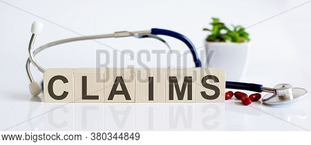 Claims The Word Is Written On Wooden Cubes And Sthetoscope And Piils . Medical Concept