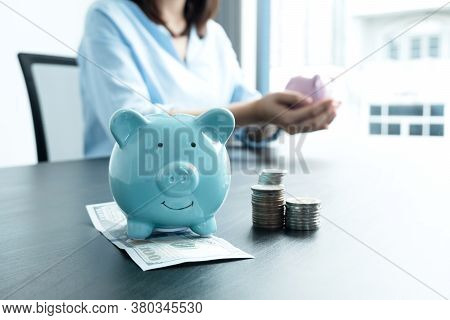 A Piggy Bank For Saving Money With A Dollar Bank A Woman Holds A Piggy Bank Into A Growing Business