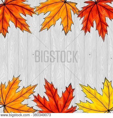 Copy Space Surrounded By Yellow, Orange And Red Maple Leaves. Frame Of Fall Auutumn Foliage On Gray