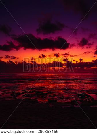 Ocean Beach With Waves And Reflection At Bright Sunset Or Sunrise In Bali.