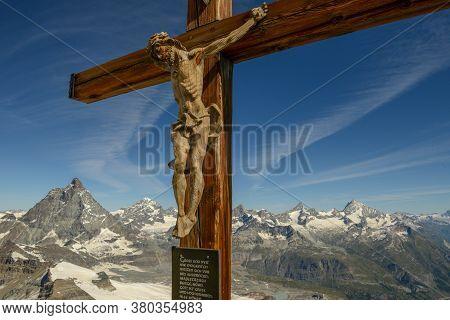 Crucifix On Mount Small Matterhorn Over Zermatt In The Swiss Alps