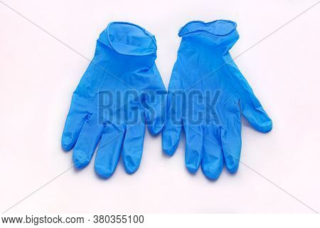Pair Of Medical Blue Latex Protective Gloves On White Background. Protective Disposable Gloves Again