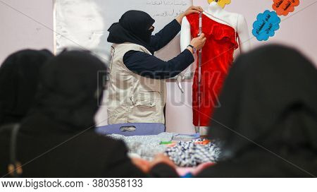 Aleppo, Syria February 13, 2020:\na Sewing Trainer Teaches Women How To Embroider