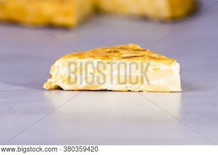 Close-up Of A Delicious Traditional Spanish Omelet On A Table On An Out Of Focus Background