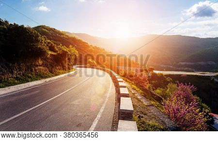 Road In Mountains. Kalabaka Region. Meteora. Greece. Empty Asphalt Road With Glowing Perfect Sky And