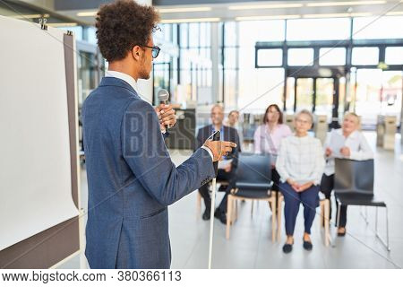 Blind businessman as a speaker at a conference or training