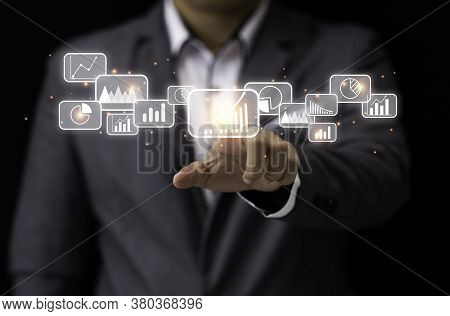 Businessman Pointing And Touching Virtual Data Graph Analysis. Big Data And Information Management W