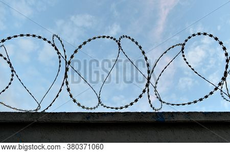 Sharp Protective Barbed Wire With Sharp Prongs On The Fence