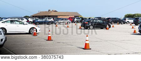 Babylon, New York, Usa - 3 August 2020: State Park Beaches Parking Lot With Orange Construction Cone