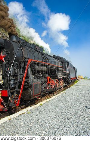 A Retro Steam Train Takes Tourists For A Journey By The Circum-baikal Railway, A Historic Rail Road.