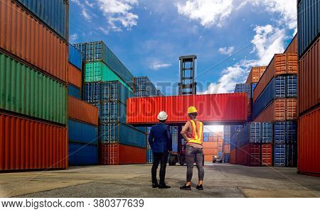 Engineer  And Industrial Workers Women  Look Forklift Truck Handling Container Box