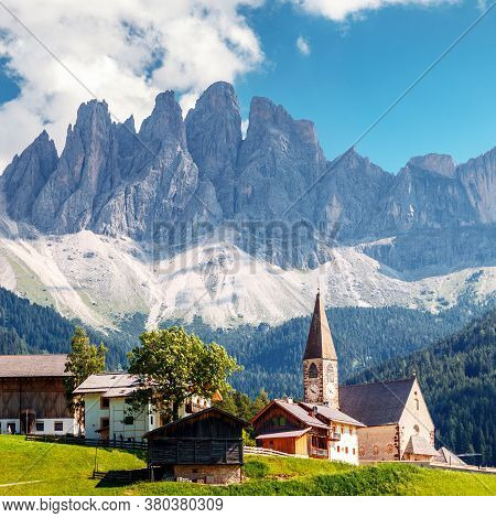 Impressively Beautiful View On Famouse Church And With The Odle Or Geisler Dolomites Mountains In Th