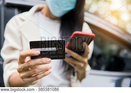 Business Woman Using Smartphone And Credit Card For Shopping Online In The Car. Business New Normal