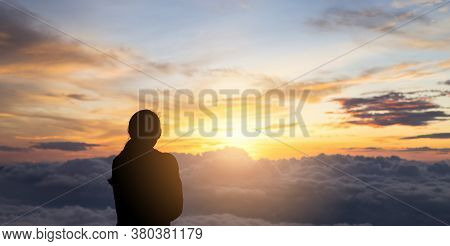 View Of Back Of The Tourist Woman Wearing A Coat Is Watching The Sunrise On The Sea Fog. Panorama Fo
