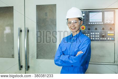 Portrait Of Beautiful Young Woman Technician In Hardhat Smiling Confidently And Crossed Her Arms At