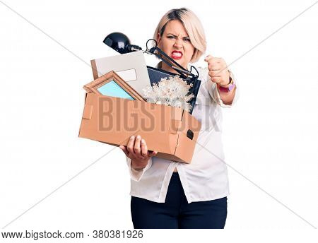 Young blonde plus size woman fired holding box annoyed and frustrated shouting with anger, yelling crazy with anger and hand raised
