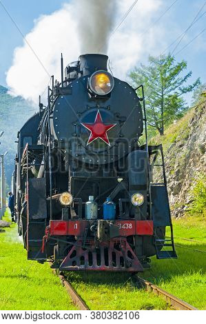Irkutsk, Russia - August 30, 2016: A Retro Steam Train Takes Tourists For A Journey By The Circum-ba