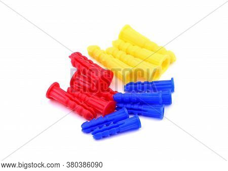 Set Of Colorful Dowels, Wall Plugs Isolated On A White Background. Dowels, Wall Plugs.
