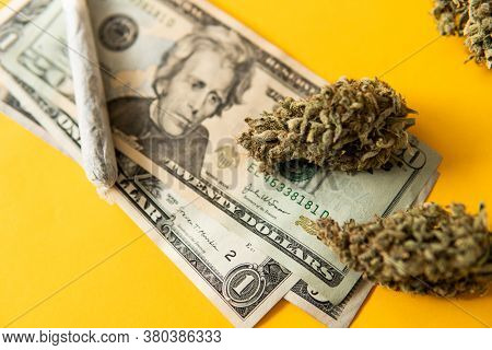 Joint Weed. Cannabis In Economics. Sativa Thc Cbd. Marijuana Weed Bud And Grinder.