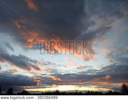 Evening Landscape With Beautiful Pale Picturesque Clouds. Evening Landscape With Clouds. Dark Clouds