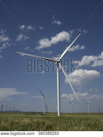 Green Energy From Windmills Produced On A Wind Farm In Pincher Creek Alberta Canada.