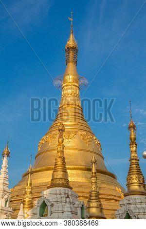 The Stupa Of The Shwedagon Pagoda In The Evening Sunlight, In Yangon, Myanmar