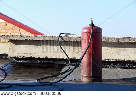 Gas Red Barrel With A Burner On The Roof
